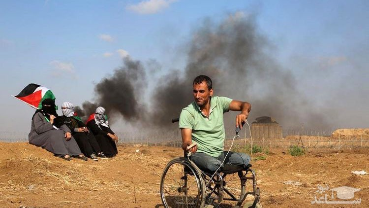 (عکس) تصویری از جوان ۲۹ساله فلسطینی که دنیا را تکان داد