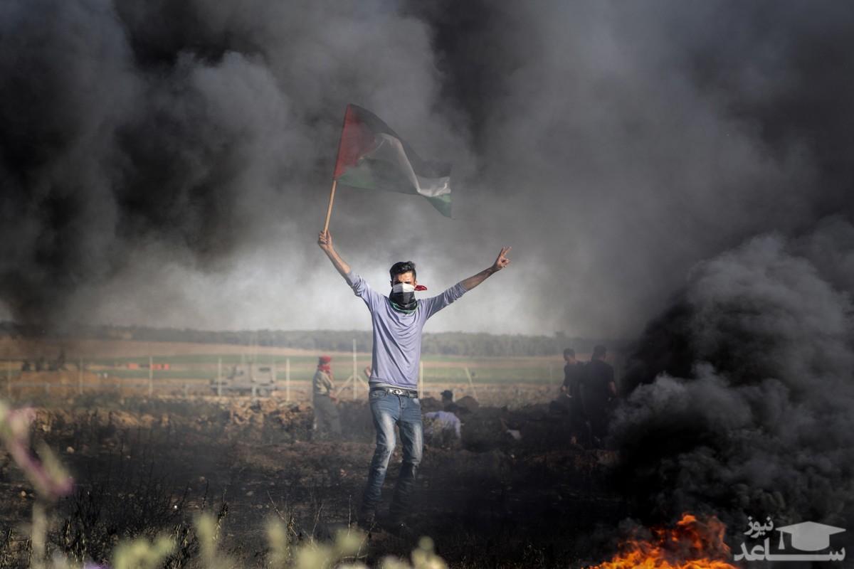 (عکس) دستگیری وحشیانه یک نوجوان فلسطینی