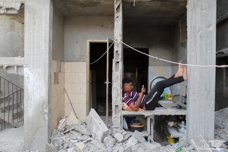 زندگی در خانه ای صدمه دیده از حملات هوایی اخیر اسراییل در جنگ 11 روزه غزه/ رویترز
