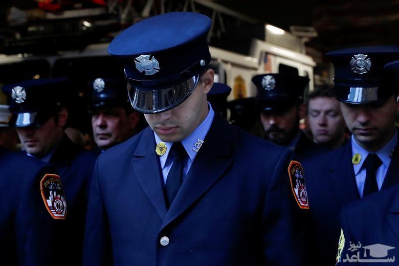 آتش نشانان شهر نیویورک در مراسم یادبود قربانیان در بیستمین سالگرد حمله 11 سپتامبر به برج های دوقلو نیویورک/ رویترز