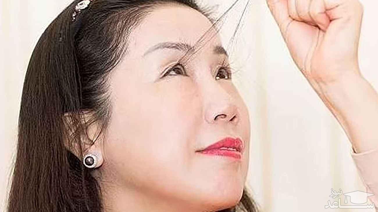 زن چینی رکوردار بلندترین مژه جهان