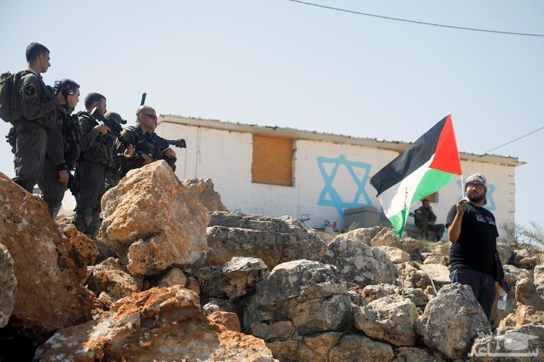 تظاهرات فلسطینیان علیه شهرک سازی های غیرقانونی اسراییل در اراضی اشغالی در کرانه باختری/ رویترز