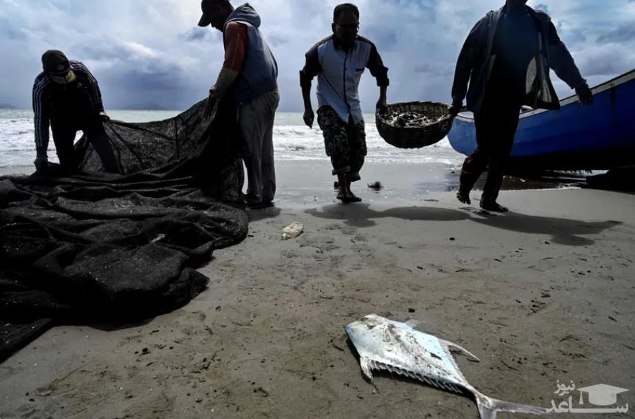 ماهیگیران در ساحل بندر آچه اندونزی