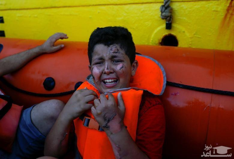 نجات یافتگان از قایق آتش گرفته پناهجویان در دریای مدیترانه
