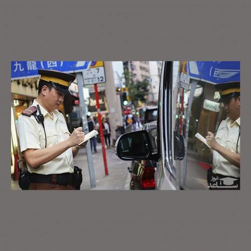 (فیلم) بیهوش شدن پلیس بر اثر گرمای شدید هوا وسط خیابان