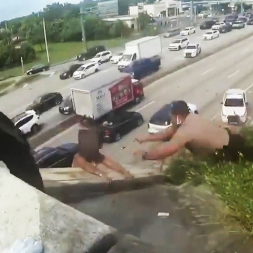 (فیلم) نجات یک مرد معلق بین زمین و آسمان توسط پلیس