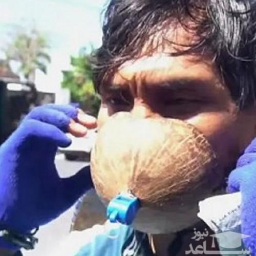 تعجب پلیس از ماسک عجیب مرد اندونزیایی! + فیلم
