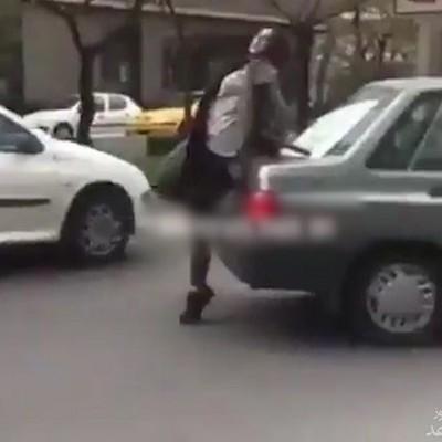 (فیلم) حمله دختر بی ام و سوار به کانکس پلیس در بلوار اندرزگوی تهران